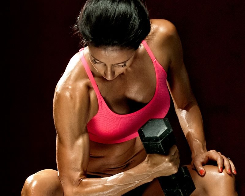 Evina Trains Biceps (Photo by Michael Healey)